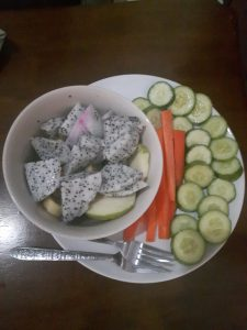 Gluten free lunch of dragon fruit, guava, cucumber and carrots