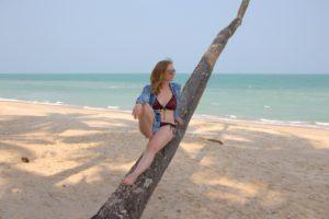 A girl on a palm tree