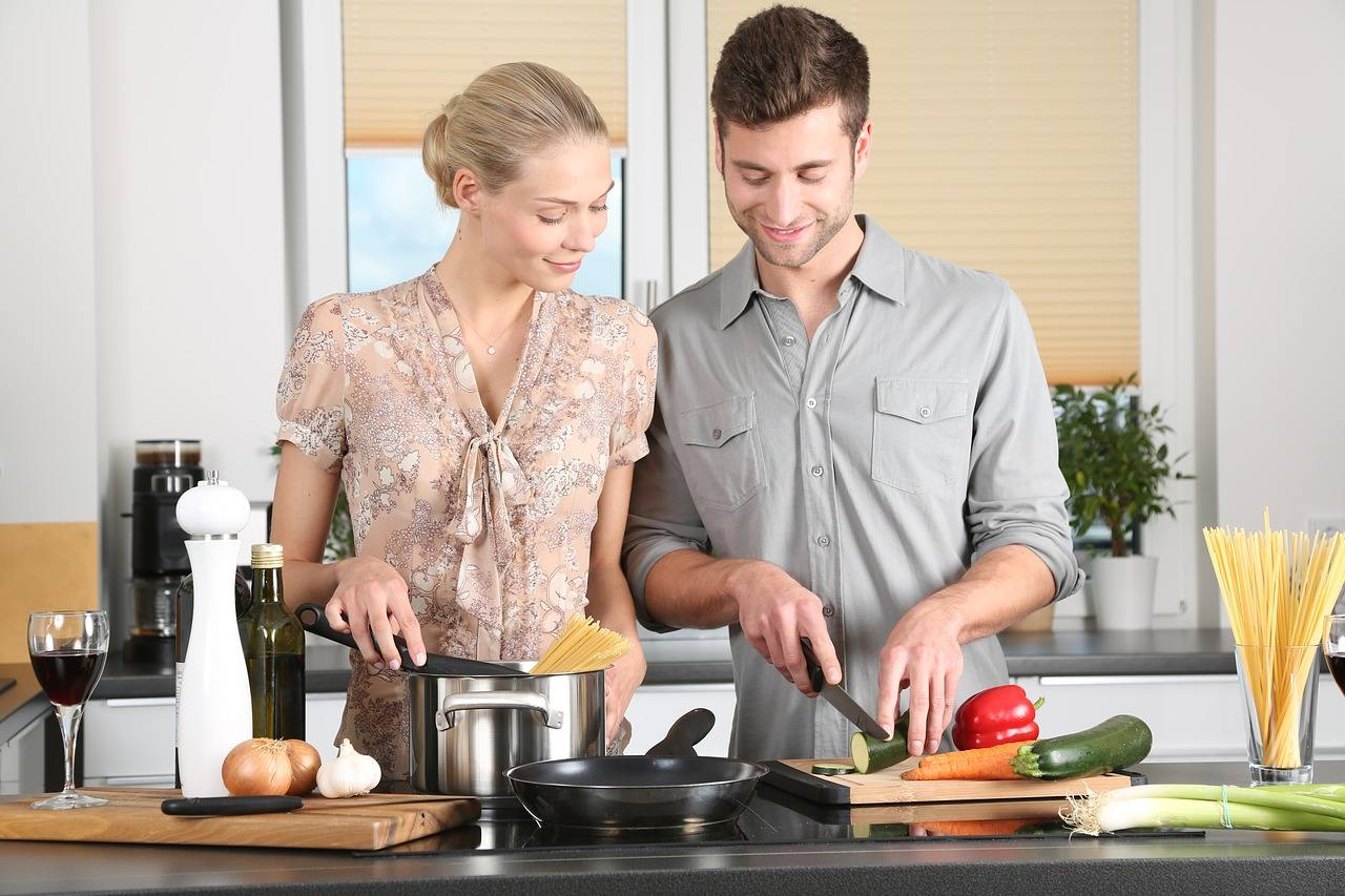 a woman and a man cooking