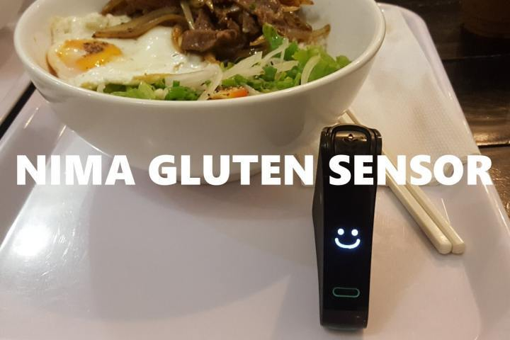 Nima Gluten Sensor on a tray and a meal